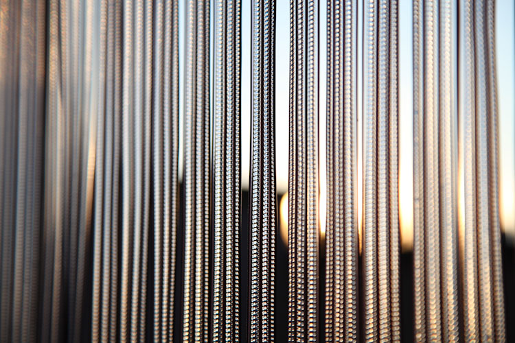 Setting sunlight sines through blinds on our back balcony.
