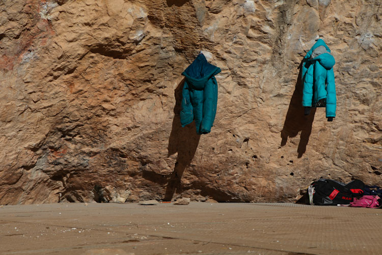 Jackets hang on the cliff in Santa Linya.