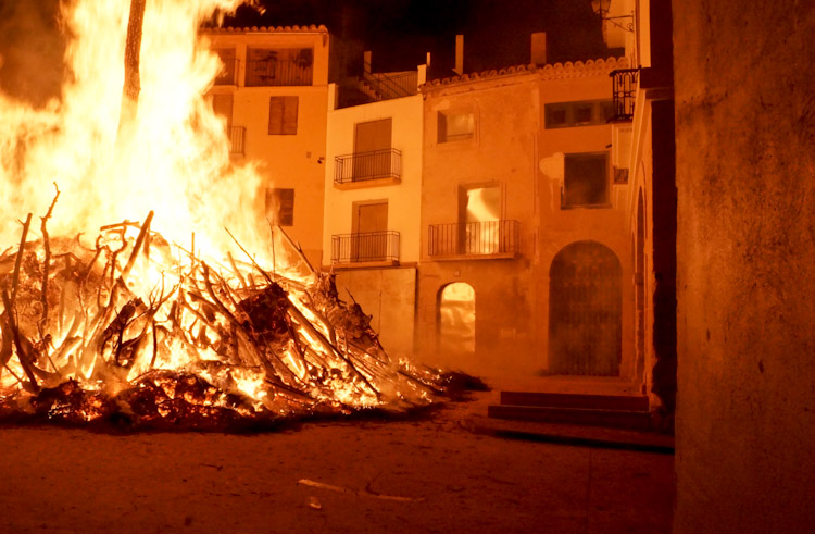 The more submissive remains of a raging fire lit in the center of the town of Castelseras, Spain as a yearly tradition.