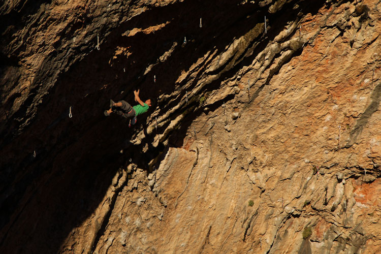 Climber uses the last minutes of daylight to send his project in Santa Linya Spain.
