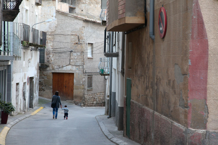 A mom and son stroll the streets in Camarasa.