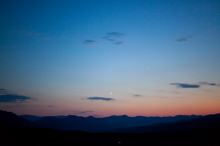 Crescent moon sunset over the valley.