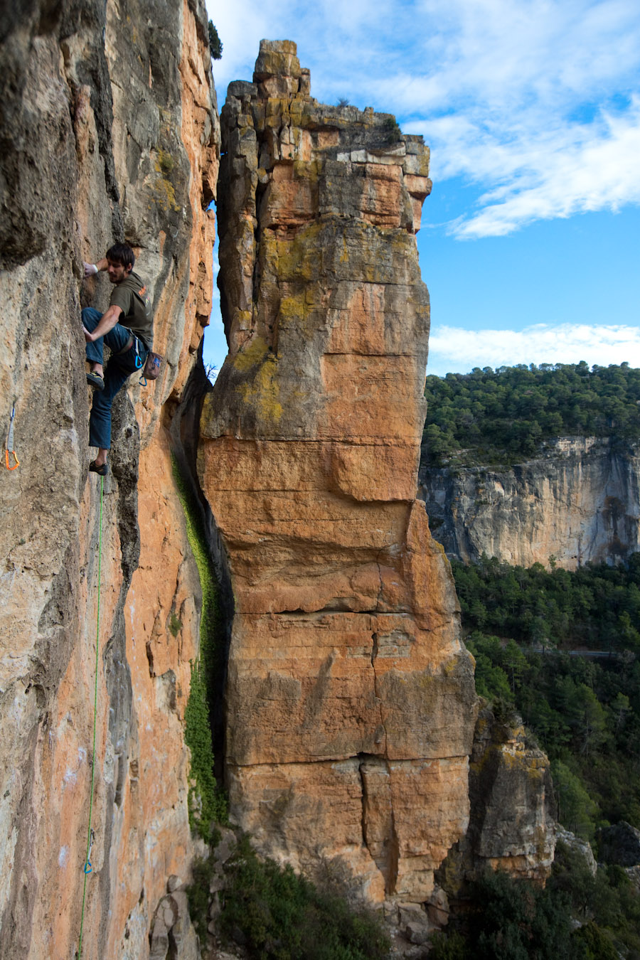 Climber enjoys the sticky conditions in the sun at El Pati sector in Siurana, Spain.