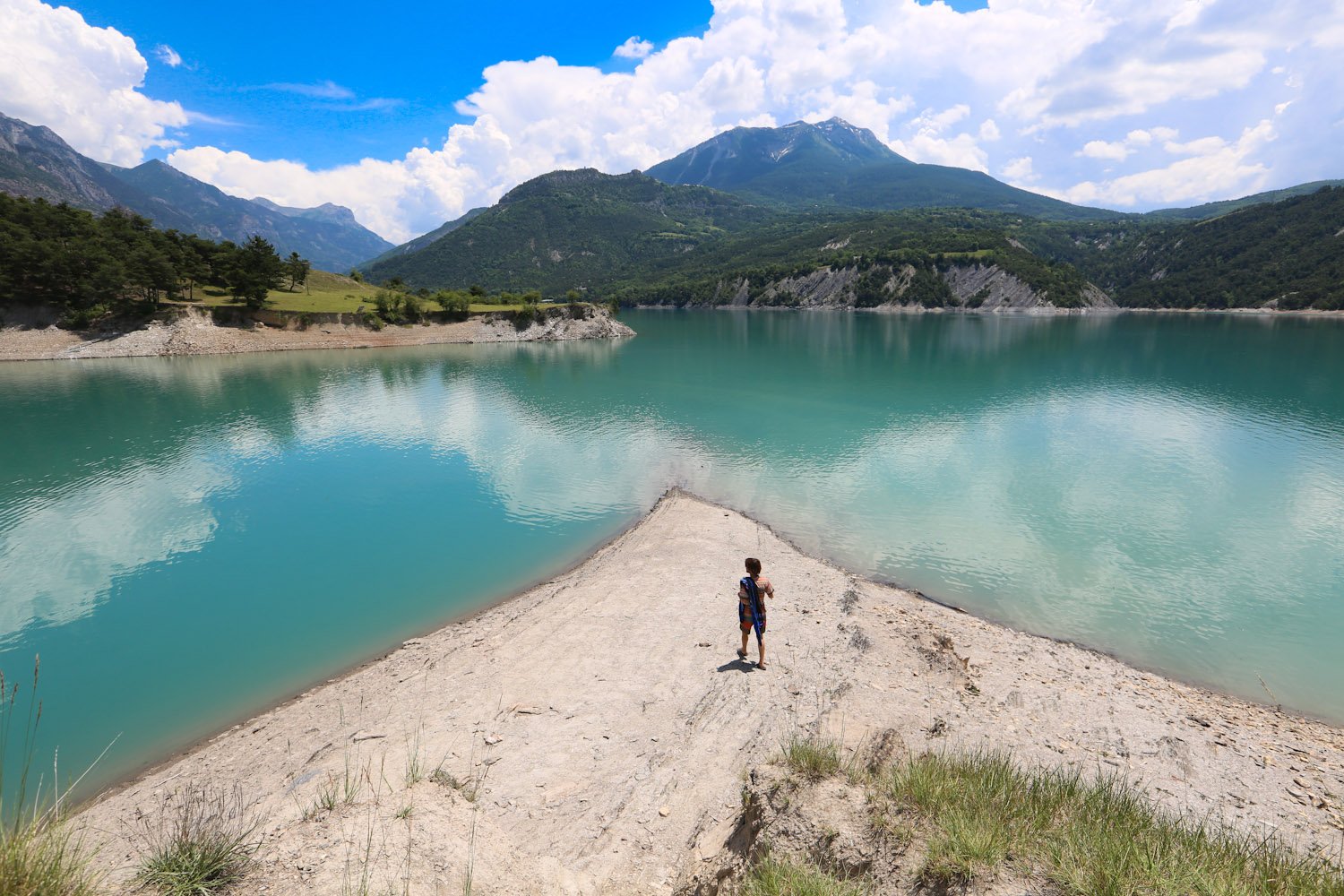 Nico enjoys the view on the lake in the Hautes- Alps Provence just outside of Gap, France.