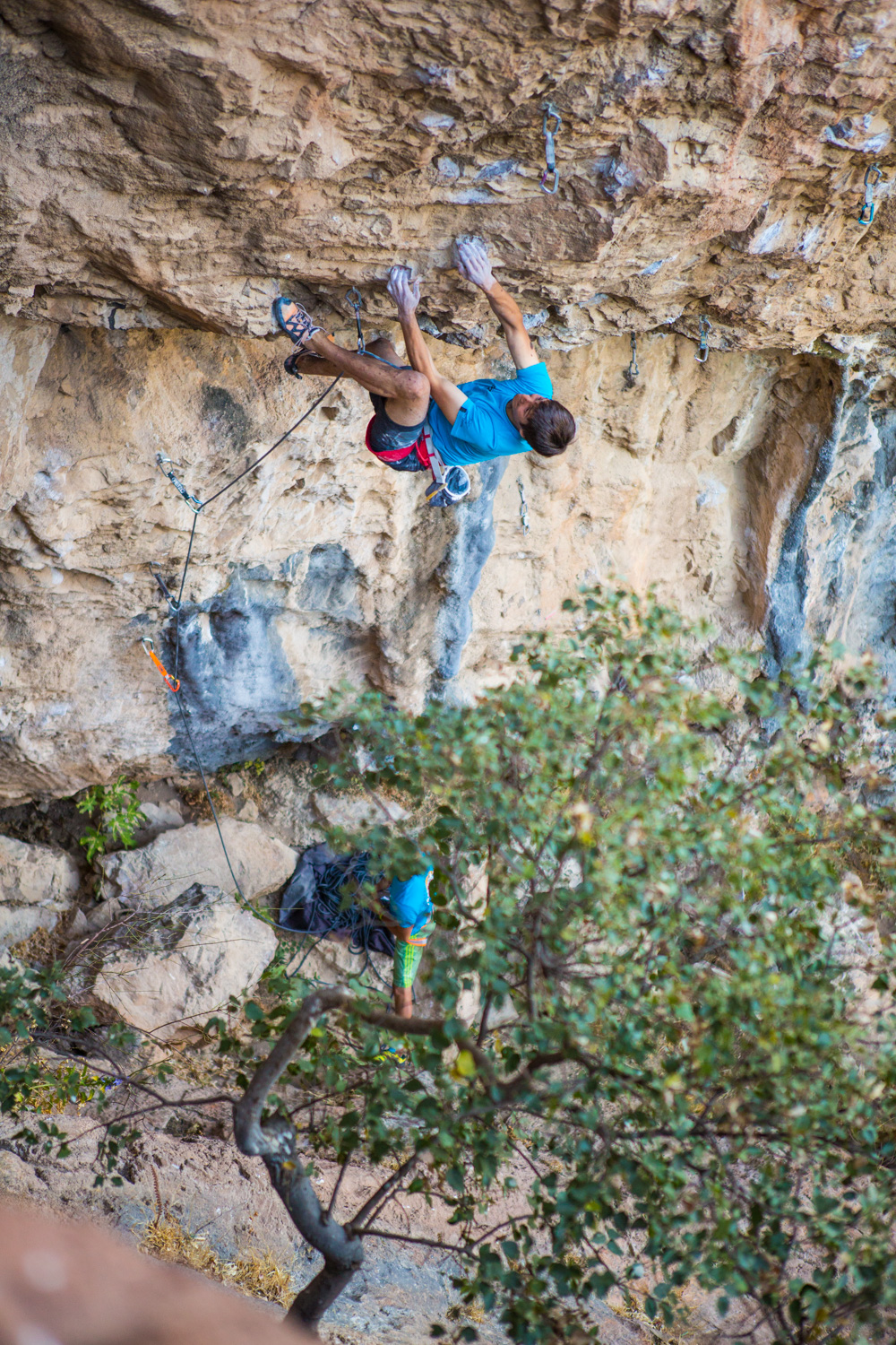 Climber David Firnenburg works the moves the day before he sends this 8c outside of Meteora, Greece.
